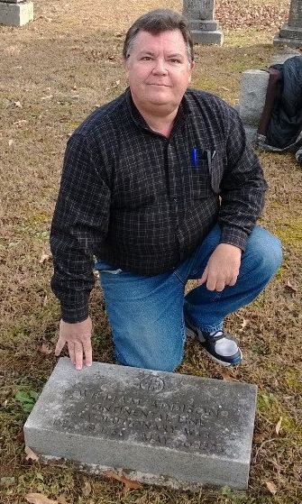 Dennis Adams at the grave of his 4th Great-Grandfather, Pvt. William Addison.