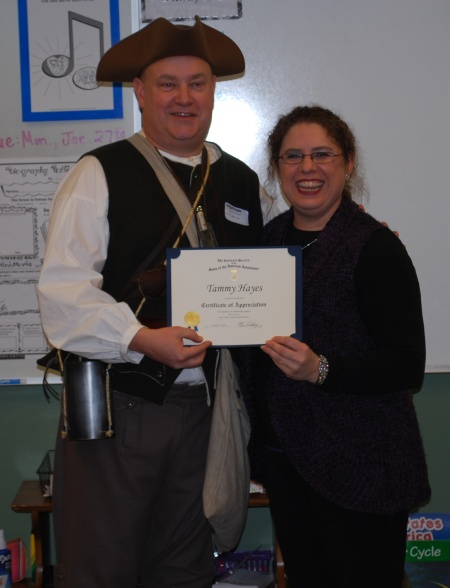Ms. Tammy Hayes receives the Certificate of Appreciation from the Col. Stephen Trigg Chapter