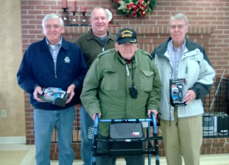 Compatriots Billy Redd (left), Geoff Baggett (back) andJames Sumner (right) visit with a Korean War veteran and resident of the W. KY Veteran's Center.