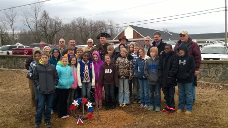 Compatriots are joined by students and staff of Trigg County Intermediate School.