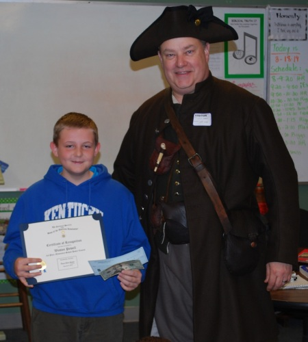 Weston is all smiles with his certificate and $70 total award!