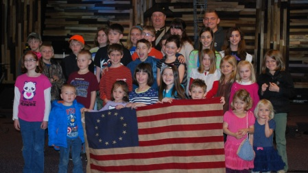 The PACHEK kids with Compatriot Baggett and a beautiful Betsy Ross flag.
