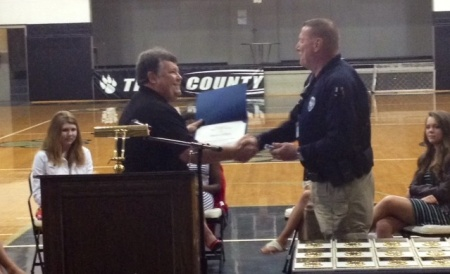 Compatriot Dennis Adams presents the Law Enforcement Commendation Medal to Resource Officer Dave Colbert