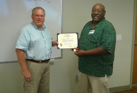 Steve Mallory Presents the Veteran's Appreciation Certificate and Medallion to O'Daniel Buckner