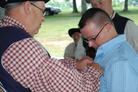 Chapter Vice-President Steve Mallory pins the medal on Mr. Broadbent.
