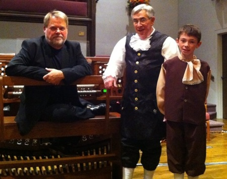 Proud grandpa and Colonial gentleman Gary Thompson and grandson Seth Clark pose with Rodney Barbour.