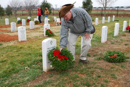 Compatriot John Humphries places a wreath on the grave of his uncle.