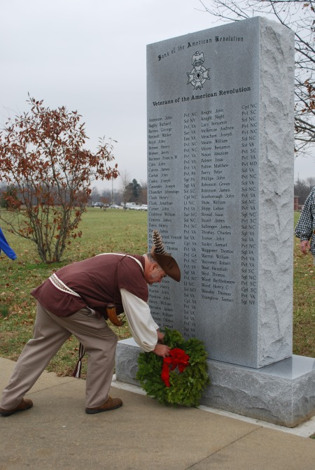 Jerry Burlingame presents a wreath at the Veterans of the American revolution Monument