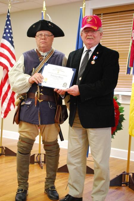 USMC Veteran Tommy Winn Receives the Veteran's Appreciation Medal from Steve Mallory