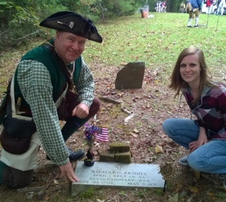 Geoff Baggett and Daughter, Katie, at the Grave of their Ancestor